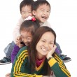 Happy Asian Mother and three kids — Stock Photo