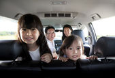 Happy family in the car — Stock Photo