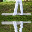 Stock Photo: Yoggirl with water reflecting