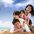 Happy family on the beach — Stock Photo #9665381