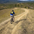 Mountain biker on the  track - Stock Photo