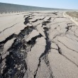 Cracked road after earthquake - Stock Photo