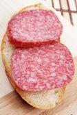 Sandwich with smoked sausage — Stock Photo