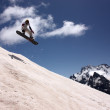 Snowboarder Flying In The Mountains - Foto Stock