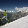 Flight skier in the mountains — Stock Photo
