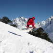 Snowboarder Flying In The Mountains — Stock Photo