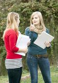 Two Polish girls schoolgirls chat — Stock Photo