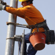 Stock Photo: Workers on electrical pylon