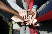 Young group with hands stacked together — Stock Photo