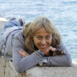 Stock Photo: Young woman lying on the dock