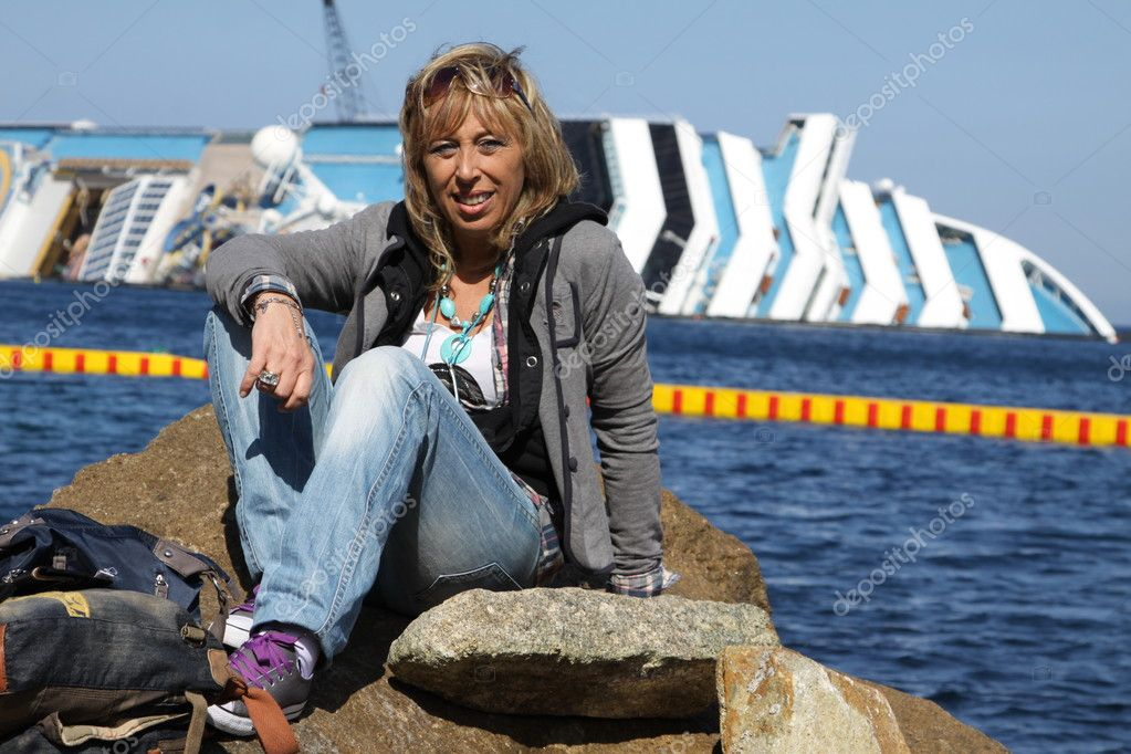 Woman on the rock in front of the Concordia  Stock Photo #9837775