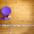Purple chair with opened book next wooden wall / modern interior — Stock Photo