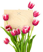 Beautiful Tulips and Empty Sign for message / wooden panel / iso — Stock Photo