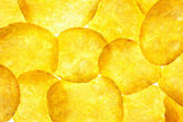 Potato Chips Background / Crisps / Macro / Back-lit — Stock Photo
