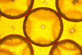 Orange slices background / macro / back lit — Stock Photo