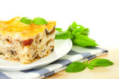 Delicious Italian Lasagna / with fresh basil / white background — Stock Photo