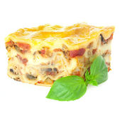 Home-baked hot Lasagne with fresh Basil / isolated on white — Stock Photo