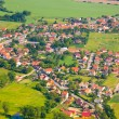 Aerial view of countryside with village and farmland — Stock Photo