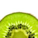 Slice of a fresh Kiwi / Super Macro / back lit — Stock Photo
