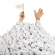Person under crumpled pile of papers with hand holding a help si — Stock Photo #9965320