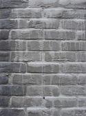 Grunge gray brick wall with white leak drip — Stock Photo