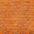 Bright orange section of a brick wall — Stock Photo