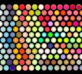 3d render of balls in multiple bright colors on black — Stock Photo