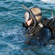 Diver in a sea water - Stock Photo