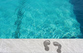Feet by the swimming pool — Stock Photo