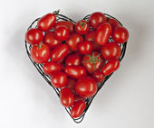 Tomatoes in a heart-shape. — Stock Photo