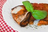 Eggplant rolls with tomato sauce. — Stock Photo