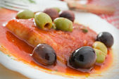 Fish with olives in tomato sauce. — Стоковое фото