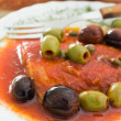 Fish with olives in tomato sauce. — Stock Photo