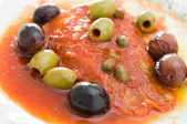 Fish with olives in tomato sauce. — Photo
