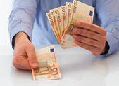 Man handling money. — Stock Photo
