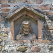 Stone Christ in wall niche. — Stock Photo #8439775