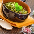 Royalty-Free Stock Photo: Peas with bacon in terracotta bowl.