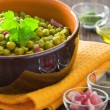 Peas with bacon in terracotta bowl. — Stock Photo