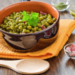 Peas with bacon in terracotta bowl. — Stockfoto