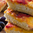 Focaccia with tomato and black olives. — Stock Photo