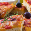 Focaccia with tomato and black olives. — Stock Photo #8613674