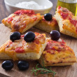 Focaccia with tomato and black olives. — Stock Photo #8613718