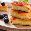 Focaccia with tomato and black olives. — Stock Photo #8625872
