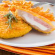 Chicken cordon bleu with grated carrots. — Stock Photo #8782069