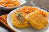 Chicken cordon bleu with grated carrots. — Photo