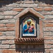 Religious icon in a wall niche. - Stock Photo