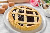 Breakfast with jam tart in white dish. — Stock Photo