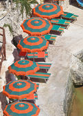 Beach umbrellas and loungers on the beach. — Stock Photo