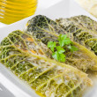 Stock Photo: Savoy cabbage rolls on white dish.