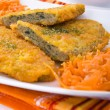 Spinach cutlet on white dish. - Stock Photo